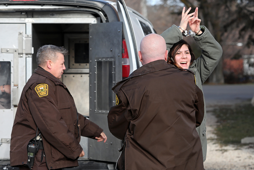 Kelsie LeSergent reacts after hearing words of support from her mother as she is escorted into the Minnedosa Provincial Court for her sentencing on Tuesday morning. (Tim Smith/The Brandon Sun)