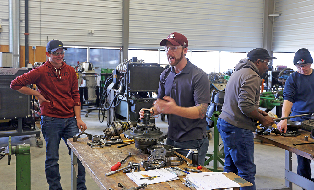 ACC instructor Kyle McDonald shows high school students the inner workings of a machine differential during an agricultural equipment boot camp on Thursday. (Colin Slark/The Brandon Sun)