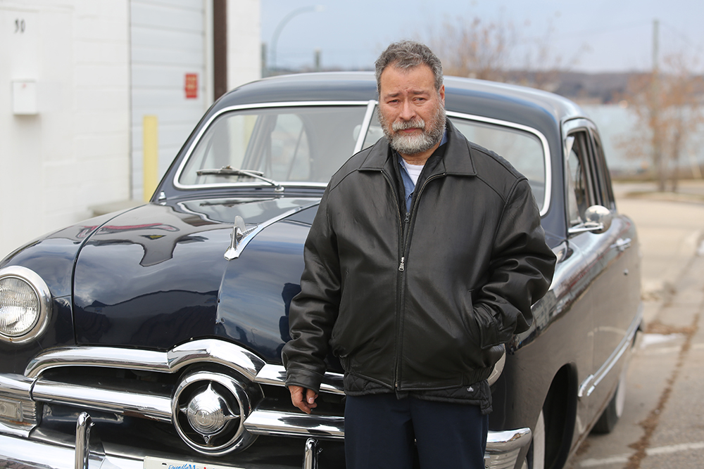 Brad Johnson of Brad's Classic Auto Services stands next to his newly acquired 1950 Ford Custom on Nov. 5. Now that fall has transitioned into winter, Johnson admits that it won't be long before he has to put this vintage car into storage until spring. (Kyle Darbyson/The Brandon Sun)