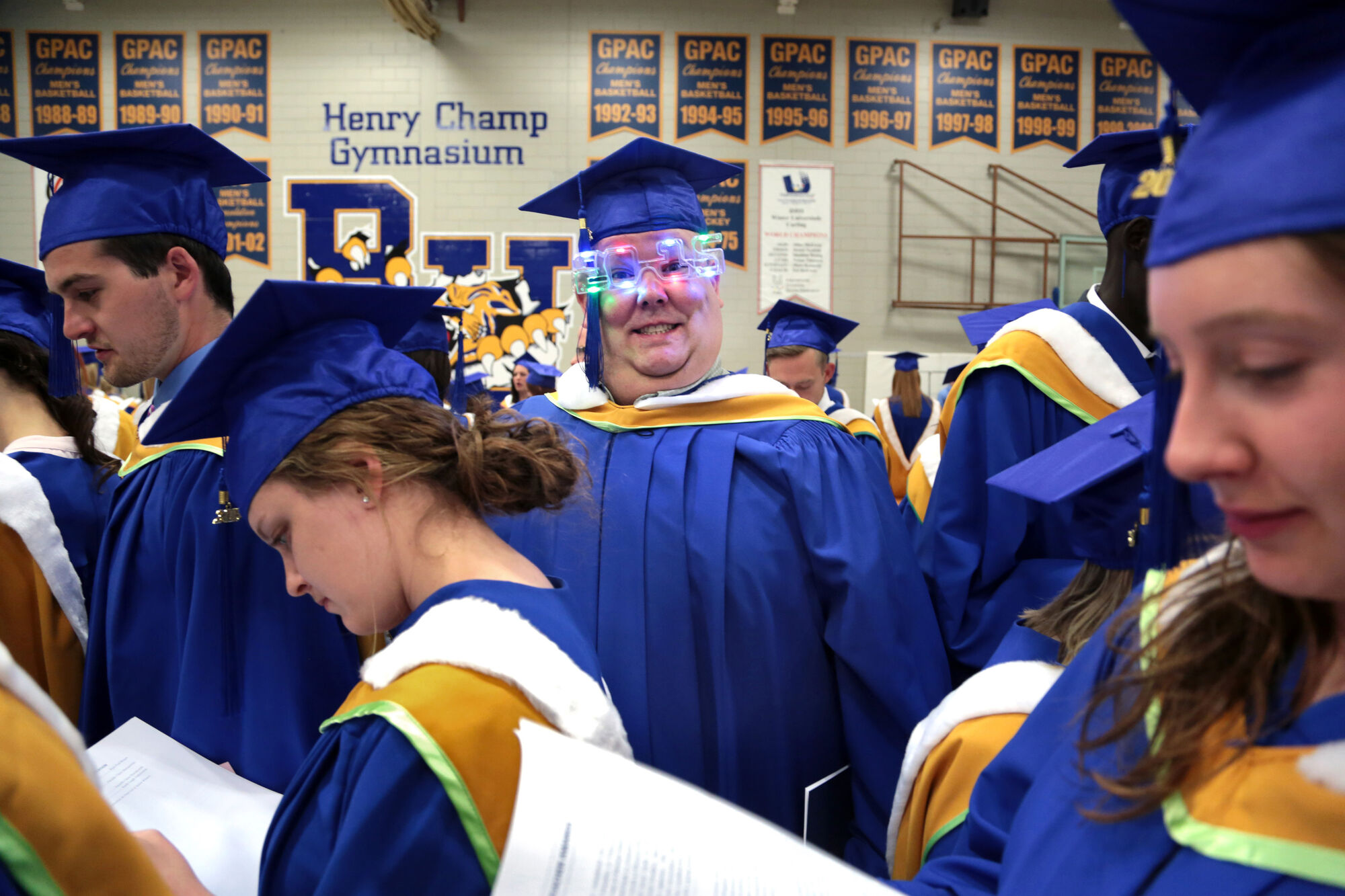 Greg Bartlett dons a pair of battery-powered glasses while awaiting Brandon University convocation exercises at the Healthy Living Centre in May.