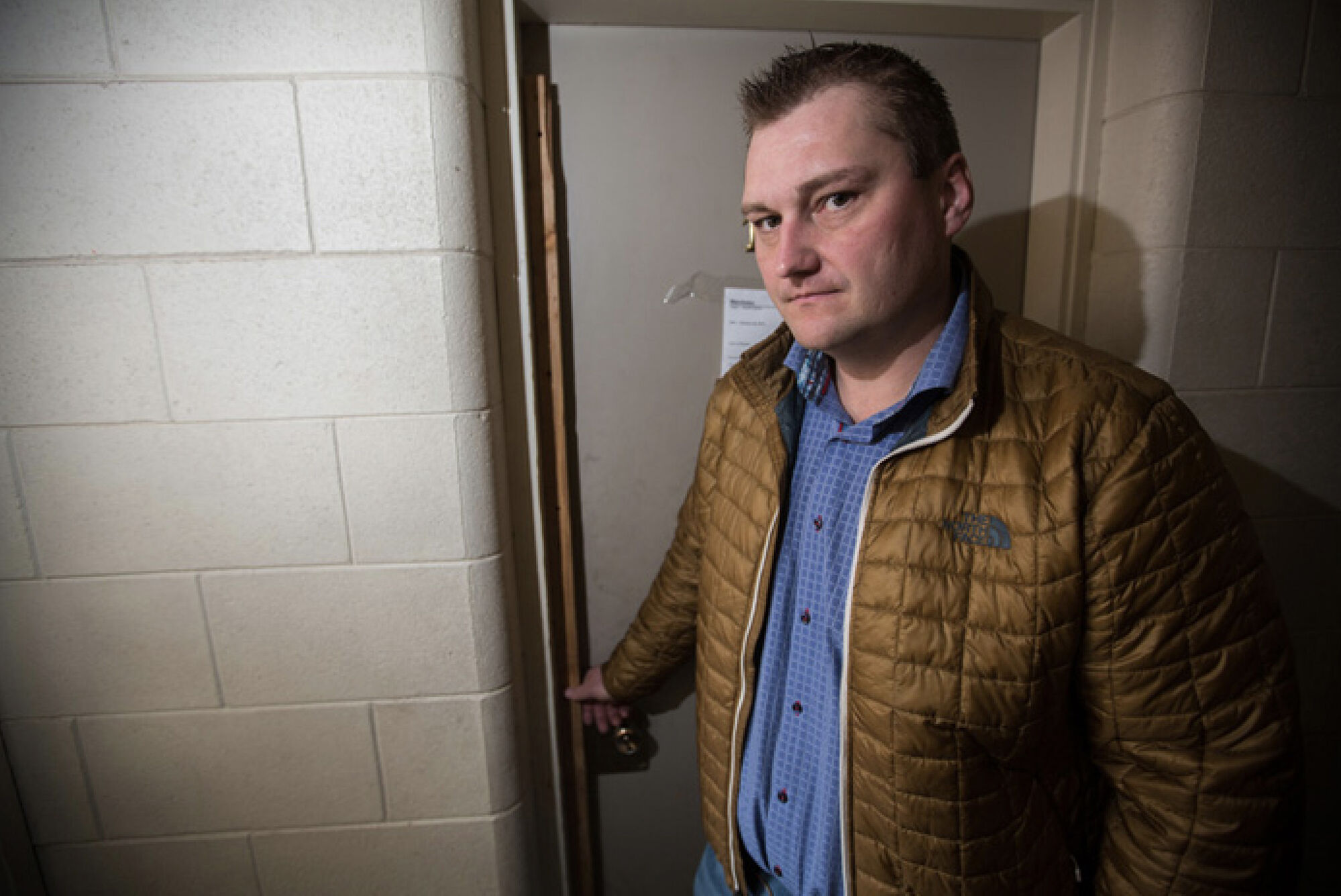Vionell Holdings Partnership CEO Jason Roblin shows a door the company was forced to screw shut after repeated break-ins from a former tenant Thursday. (Chelsea Kemp/The Brandon Sun)