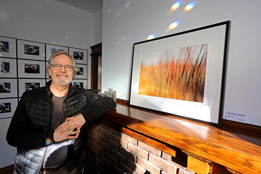 Doug Derksen deliberately moved his camera while taking photos for the exhibit to produce a blur effect. (Colin Slark/The Brandon Sun)