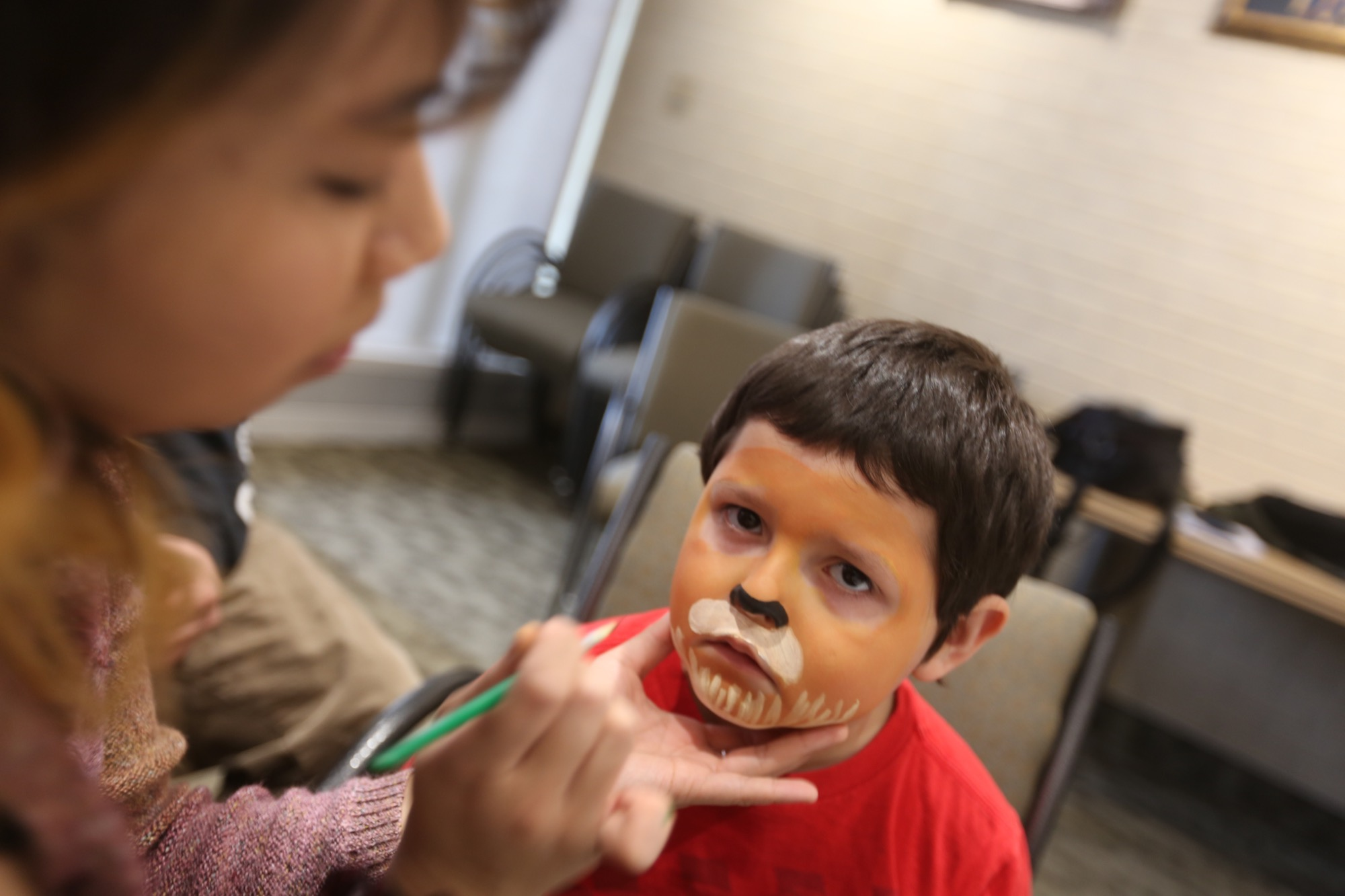 Zane Puga-Nissen takes some time out from the main celebrations in Harvest Hall for a bit of face painting in the Louis Riel Room. (MICHELE LETOURNEAU/THE BRANDON SUN)