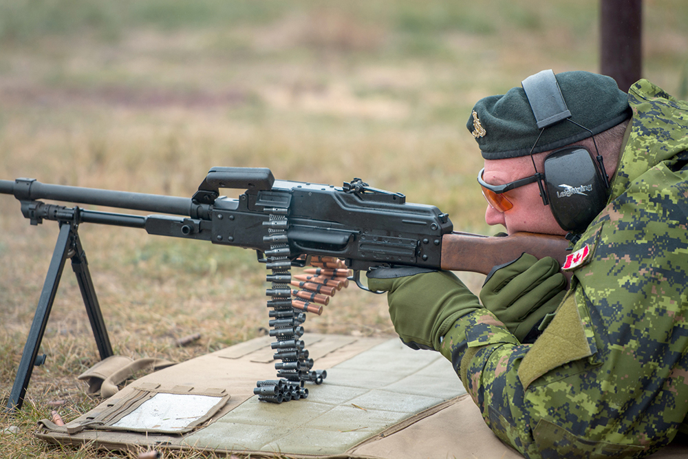 A 1RCHA soldier takes aim with a foreign weapon during a visit to Wolverine Supplies in Virden a couple years ago. (File)