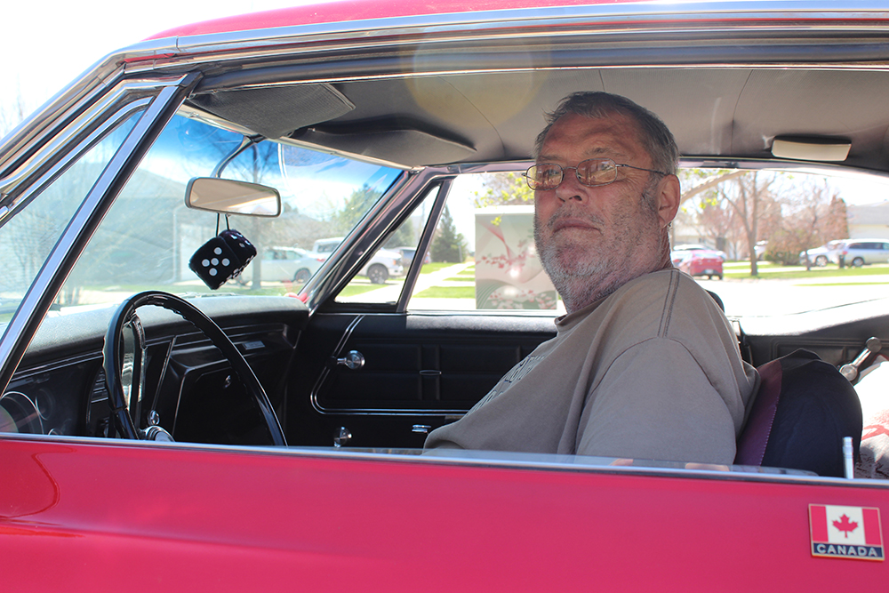 Jerry Erickson gets behind the wheel of his 1967 Chevrolet Impala this past Monday afternoon in Brandon. (Kyle Darbyson/The Brandon Sun)