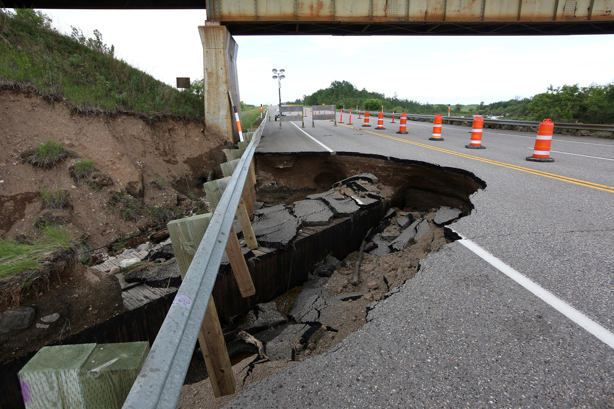 A portion of Highway 10 washed away at the rail underpass north of Forrest during flooding caused by Sunday's powerful storm activity. The highway was partially opened to traffic again on Tuesday afternoon.