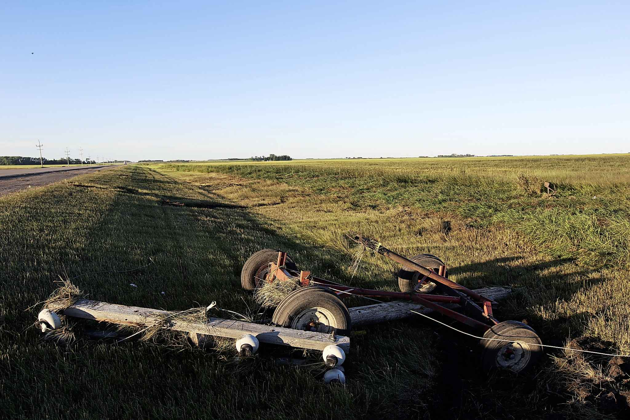 Debris is scattered through the ditch and field west of Highway 83 near Scarth, Man. on Saturday. after a powerful tornado tore through the area Friday evening. (Tim Smith/The Brandon Sun)