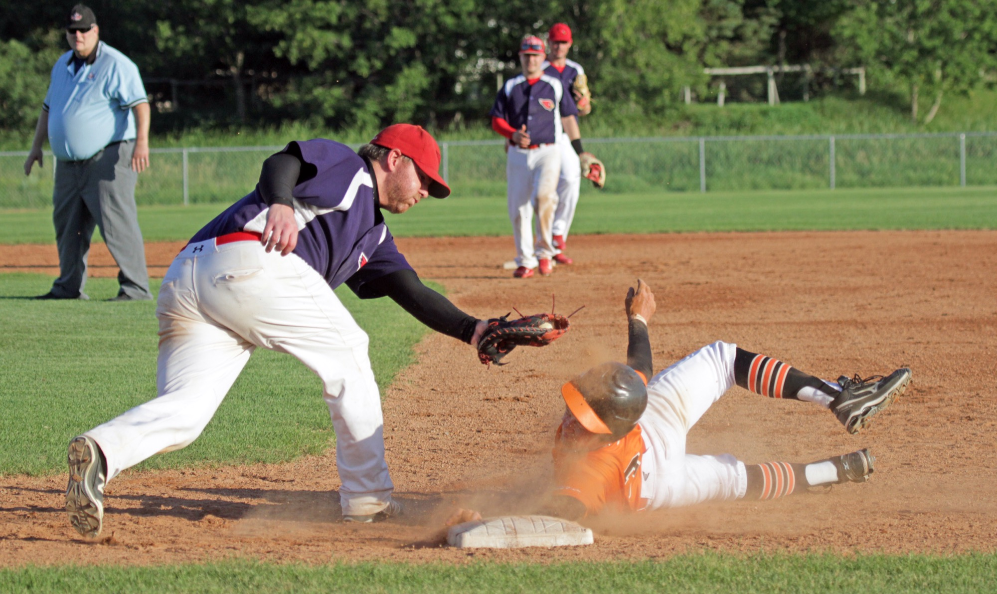 RFNOW Cardinals first baseman Joel Krentz attempts to complete a double play, but Giants baserunner Ian Barr evades the tag during Game 1 of their Andrew Agencies Senior AA Baseball League semifinal at Sumner Field on Thursday.