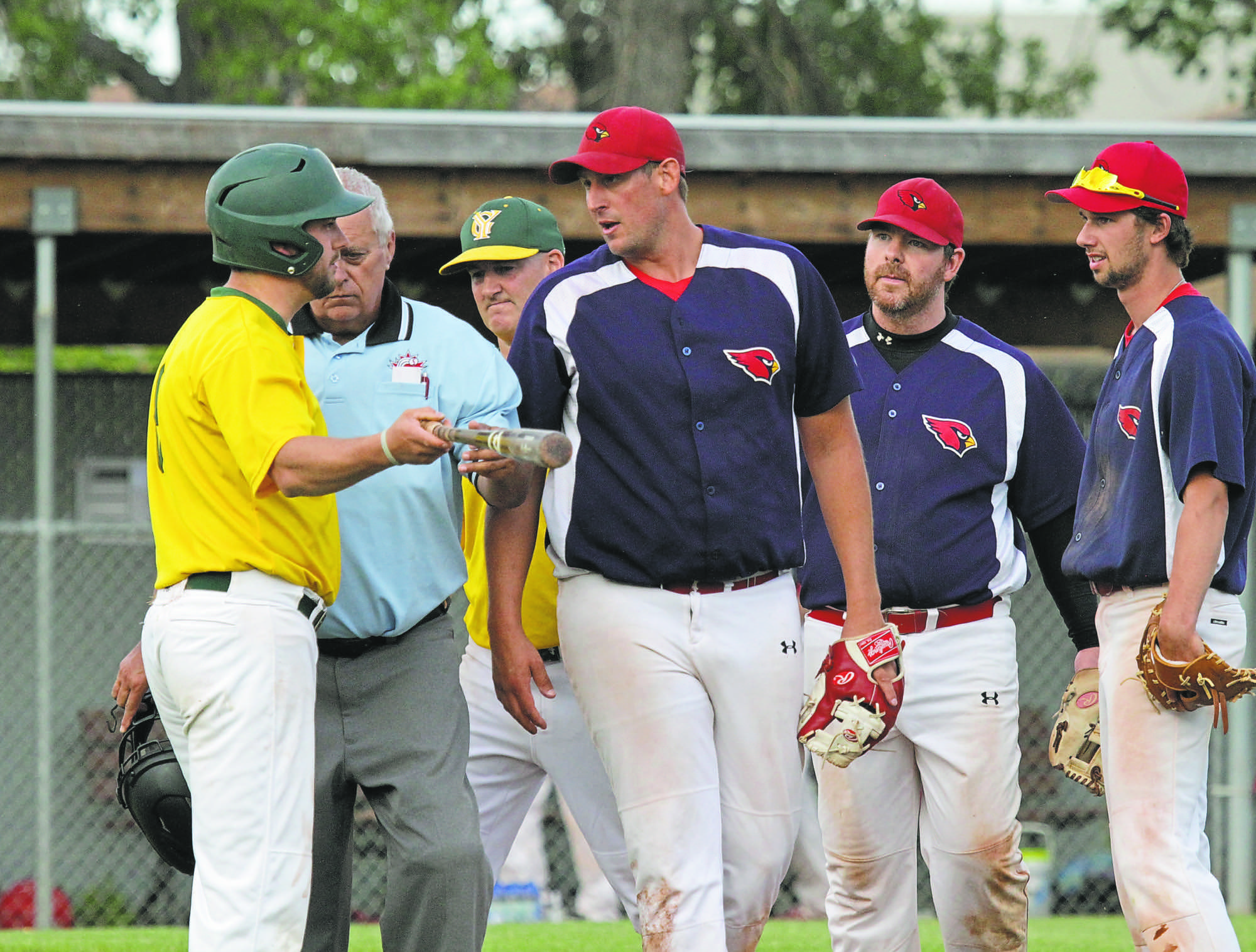 RFNOW Cardinals pitcher Adam Hartman and GW Vacuum Truck Service Young Guns Brandon Lockerby exchange words while Cardinals Joel Krentz and Max Paddock look on, after Lockerby collided with Hartman on a pop-up down the first-base line. Lockerby was called out for interference and the Cards went on to take Game 1 of the Andrew Agencies Senior AA Baseball League final 4-3 at Sumner Field on Tuesday. (Thomas Friesen/The Brandon Sun)