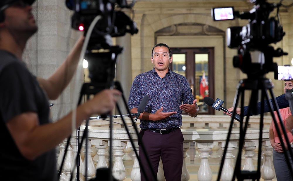 Manitoba NDP Leader Wab Kinew speaks during a media conference in Winnipeg on Friday