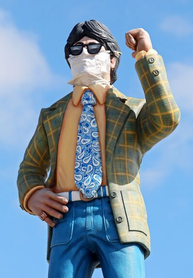 The statue above First Street First on Richmond Avenue in Brandon wears a mask as a sign of the times. However, as of Saturday, the province is loosening restrictions, including the need for wearing masks inside public places.
