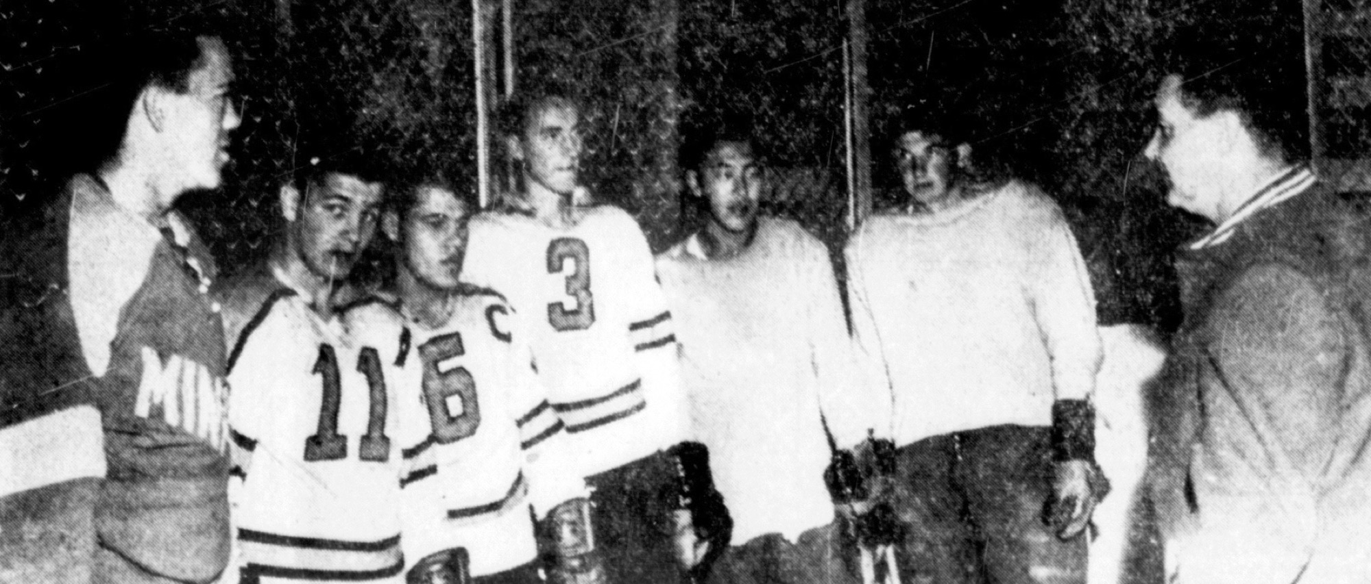 New Brandon Wheat Kings head coach (Sugar) Jim Henry, right, speaks to hopefuls, left to right, Darryl Tillsley, Doug Cronk (11), Sid Boyer (6), Larry Brown (3), Danny Namba of Dominion City and Bill Mikkelson of Brookdale at the team's training camp on Sept. 26, 1964.