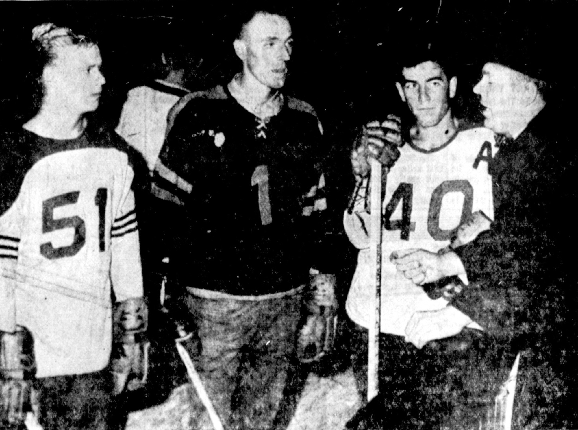 Brandon Wheat Kings coach Eddie Dorohoy, right, speaks to Juha Widing, Larry Brown and Erv Ziemer on Sept. 24, 1965 during the team's training camp for the 1965-66 season. More than 110 players attended.