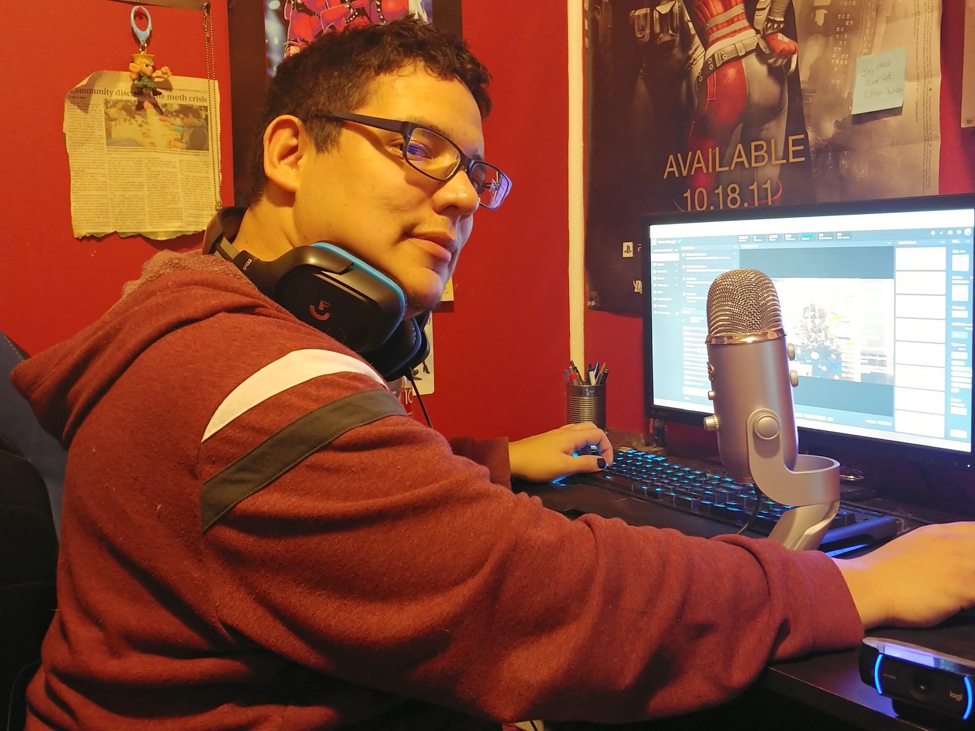Gamer Joseph Canada sits in front of his computer, which is set up to livestream Twitch broadcasts of his gaming.