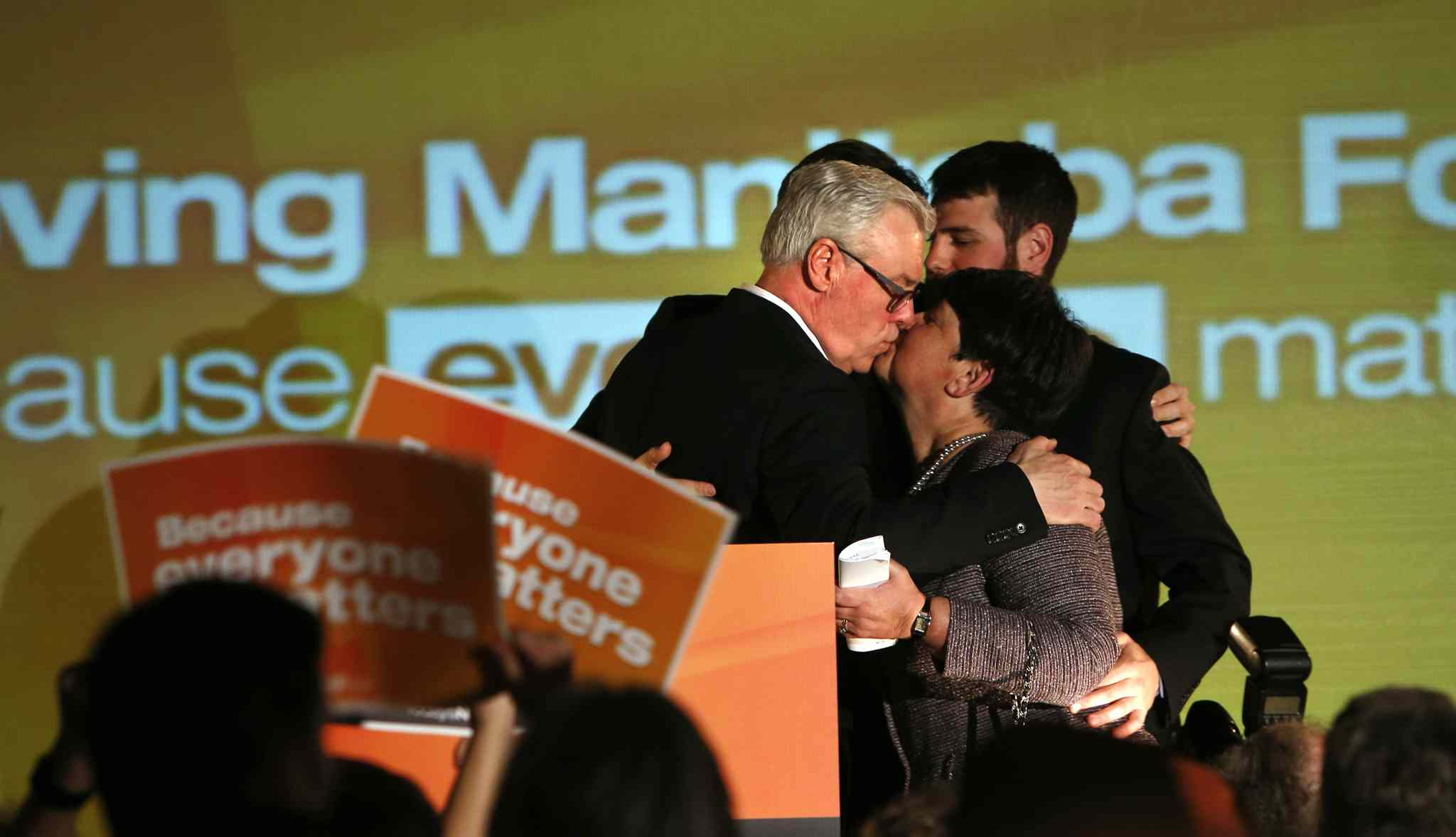 Greg Selinger gives his his wife Claudette a kiss on the stage at the NDP post election gathering at the RBC Convention Centre.