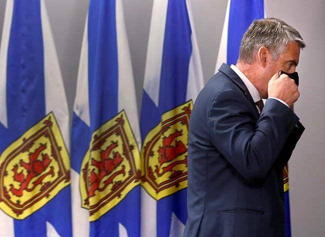Nova Scotia Premier Stephen McNeil adjusts his face mask after announcing that he is stepping down as party leader and premier at a news conference in Halifax on Thursday, Aug. 6, 2020. Nova Scotia has become the latest province to adopt the federal government's COVID-19 smartphone application. THE CANADIAN PRESS
