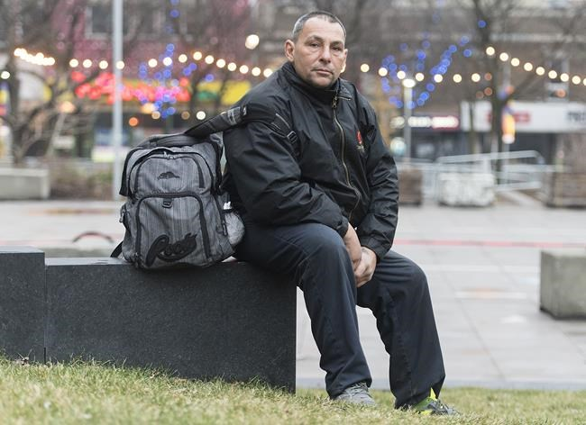 Sylvain Di Lallo poses for a portrait outside Hotel Place Dupuis in Montreal, Saturday, Dec. 5, 2020. Shelter workers and experts all agree that the pandemic has made homelessness more visible and disrupted the way people access both formal and informal services. THE CANADIAN PRESS/Graham Hughes