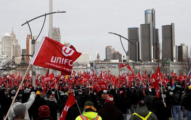 Supporters for Unifor, the national union representing auto workers, attend a rally in Windsor, Ont., across from the General Motors headquarters in Detroit on Friday, Jan. 11, 2019. GM earned the ire of Canadian auto workers in 2018 by announcing the closure of its assembly plant in Oshawa, Ont. It later resurrected the facility with a $170-million investment to retool it for autonomous vehicles. THE CANADIAN PRESS/AP-Carlos Osorio