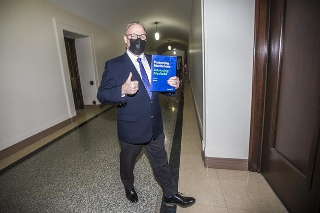 Manitoba Finance Minister Scott Fielding walks in to speak to the media about the 2021 budget at the Manitoba Legislative Building in Winnipeg on Wednesday, April 7, 2021. THE CANADIAN PRESS/Mikaela MacKenzie - POOL
