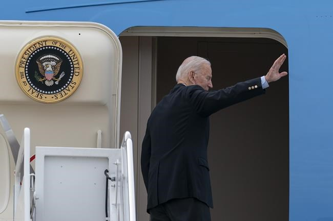 President Joe Biden waves as he boards Air Force One upon departure, Wednesday, June 9, 2021, at Andrews Air Force Base, Md. Biden is embarking on the first overseas trip of his term, and is eager to reassert the United States on the world stage, steadying European allies deeply shaken by his predecessor and pushing democracy as the only bulwark to the rising forces of authoritarianism. (AP Photo/Alex Brandon)