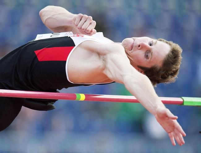 Canada's Derek Drouin clears the bar in the men's high jump final at the 2015 Pan Am Games in Toronto on Saturday, July 25, 2015. THE CANADIAN PRESS/Frank Gunn