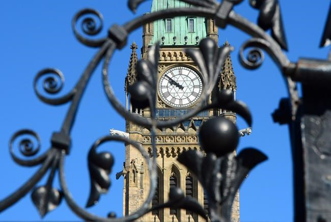 The Peace Tower is framed through the front gates of Parliament Hill in Ottawa on Thursday, April 13, 2017.The federal government plans to launch a national ad campaign aimed at making more white Canadians knowledgeable about systemic racism.THE CANADIAN PRESS/Sean Kilpatrick