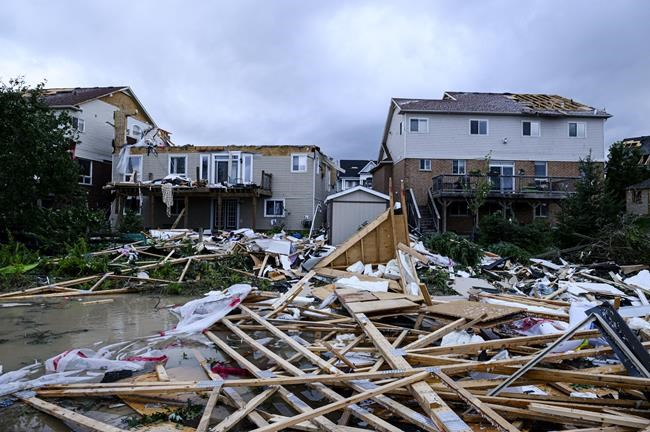 Damage left after a tornado touched down in a neighbourhood of Barrie, Ont., on Thursday, July 15, 2021. THE CANADIAN PRESS/Christopher Katsarov
