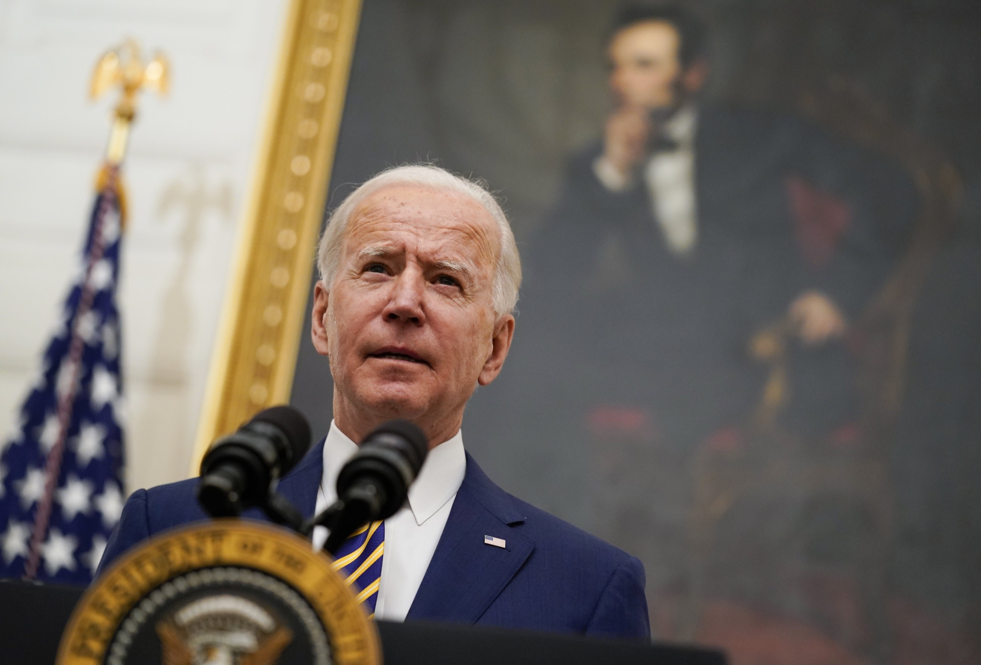 U.S. President Joe Biden speaks about the economy in the State Dining Room of the White House on Friday. (Associated Press)