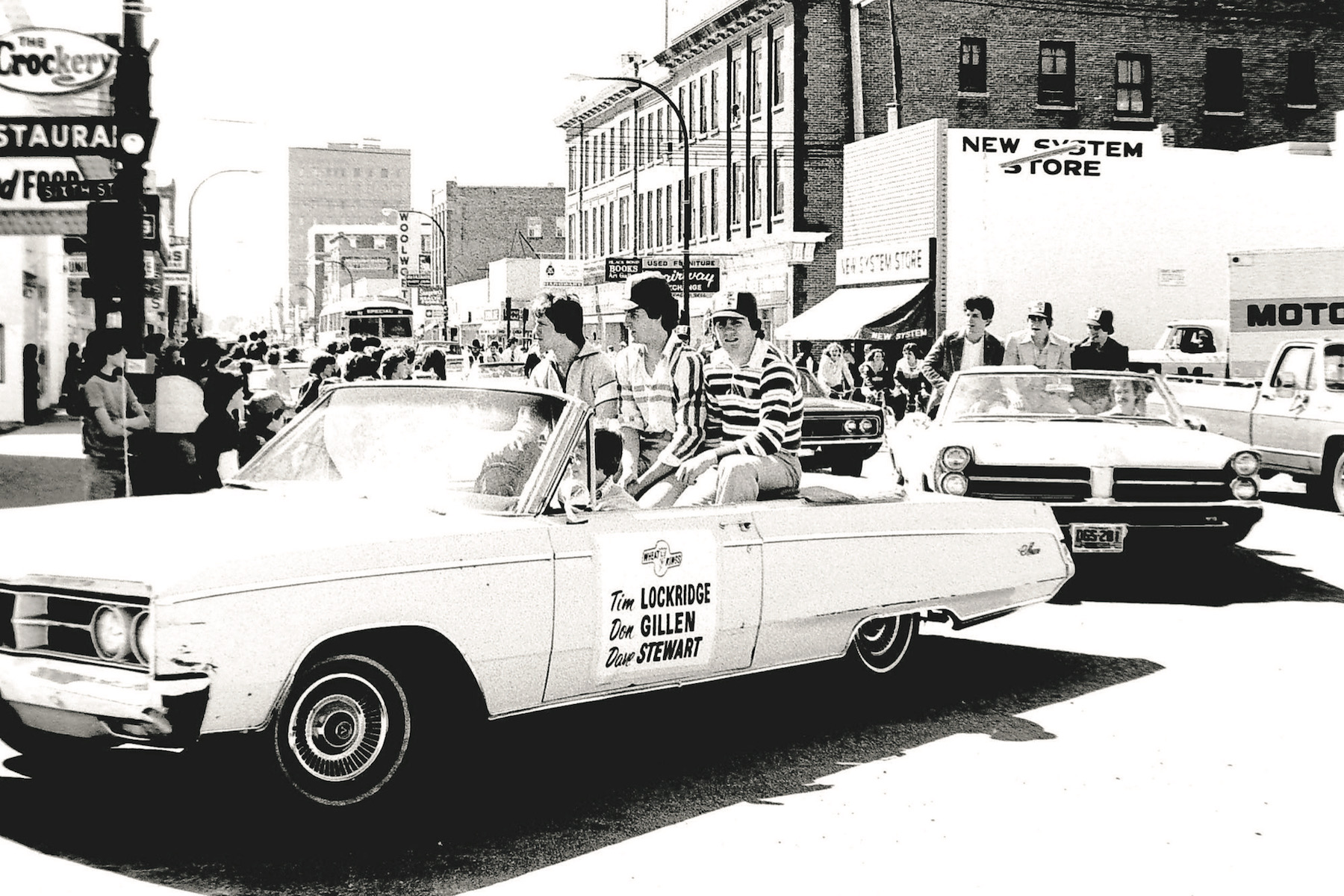 Dave Stewart, left, rides in a convertible with teammates Tim Lockridge, right, and Don Gillen, centre, during a parade held for the Wheat Kings in the spring of 1979.