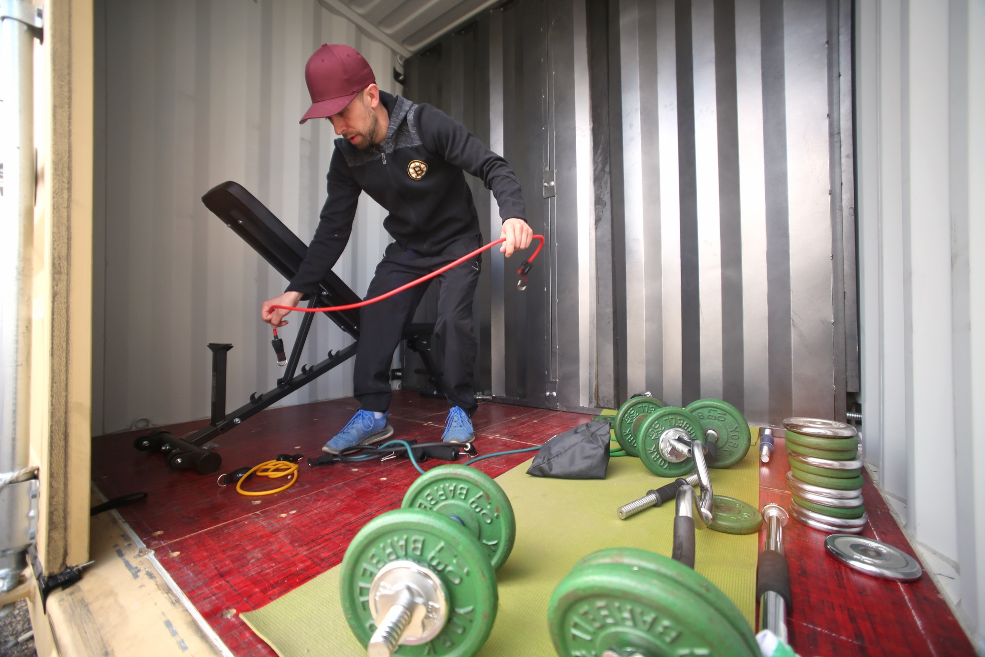 Ryan Pandolfi sets up his storage container gym for a workout on Saturday.