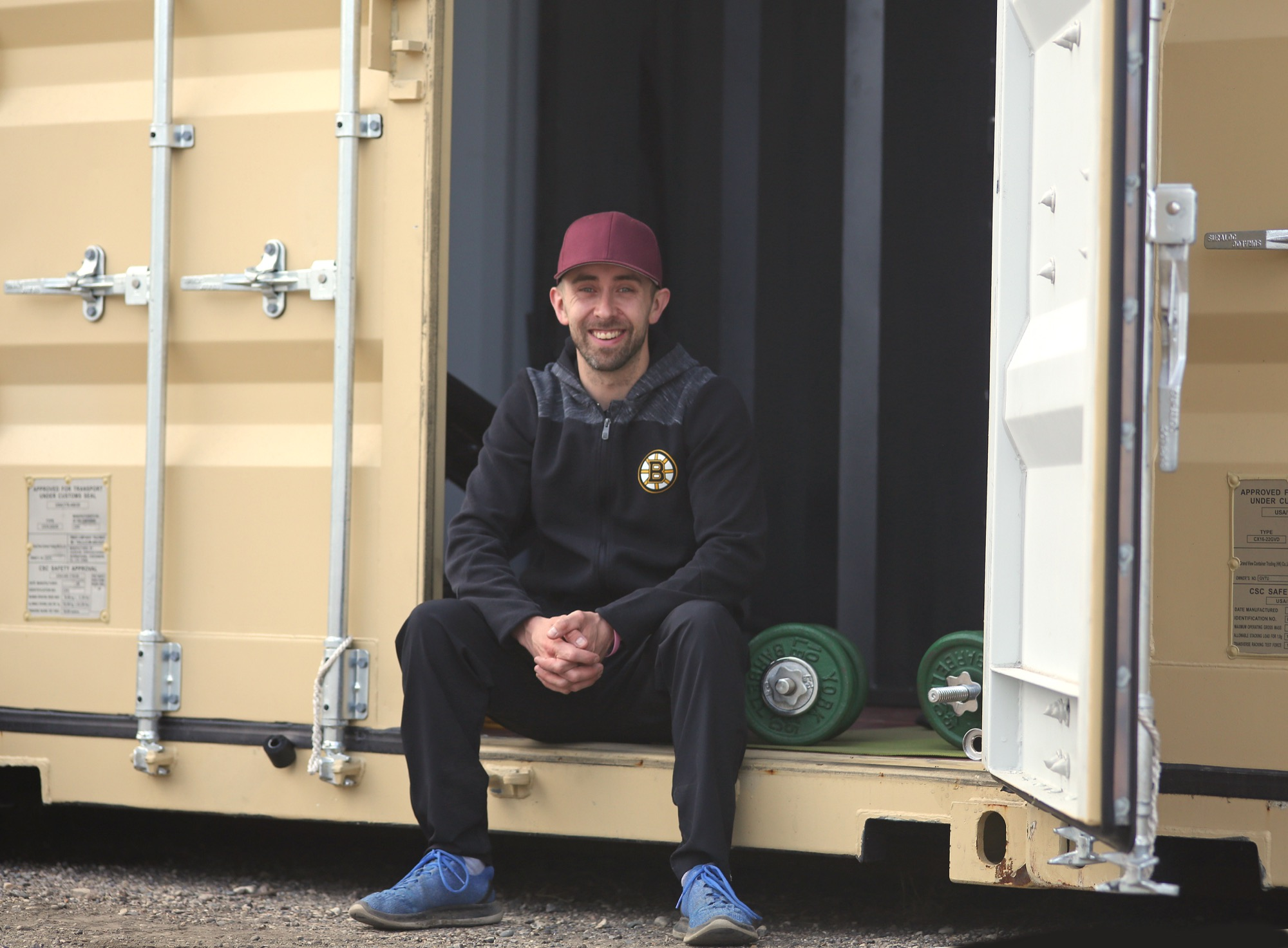 Ryan Pandolfi is seen Saturday at his makeshift storage container gym, which he put together southeast of Brandon after the latest round of health restrictions shuttered gyms and fitness centres for the balance of the month.
