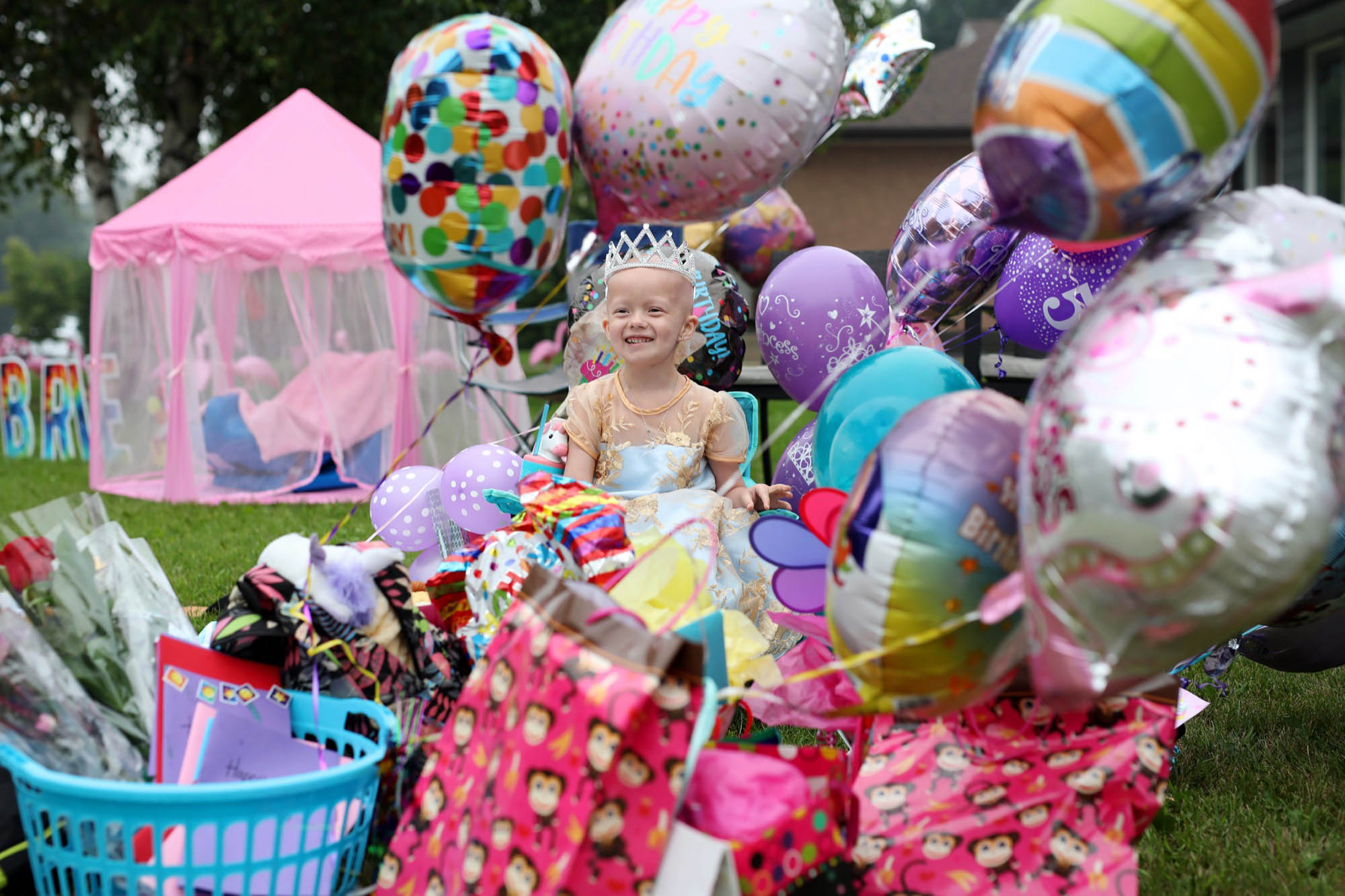 Five-year-old Brie Hall is surrounded by some of the presents she received during a special birthday parade on Tuesday evening. Dozens of vehicles lining multiple city blocks paraded past Brie, who has Ewing sarcoma, a rare type of cancer, dropping off presents and wishing her a happy birthday. Brie was diagnosed with cancer on Jan. 6, 2021 and travels to Winnipeg for chemotherapy treatment every two weeks.  (Tim Smith/The Brandon Sun)