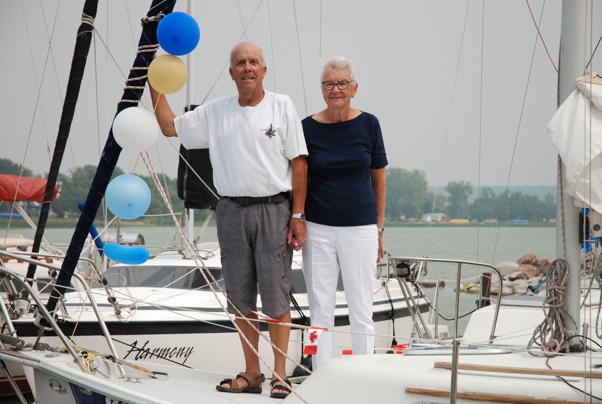 Alf and Betty Iverson stand on the deck of Alfabet, their 25 foot Siren sailboat. The Iverson's have been sailing since the 1990s. The couple has no plan of hanging up Alfabet's sails anytime soon.