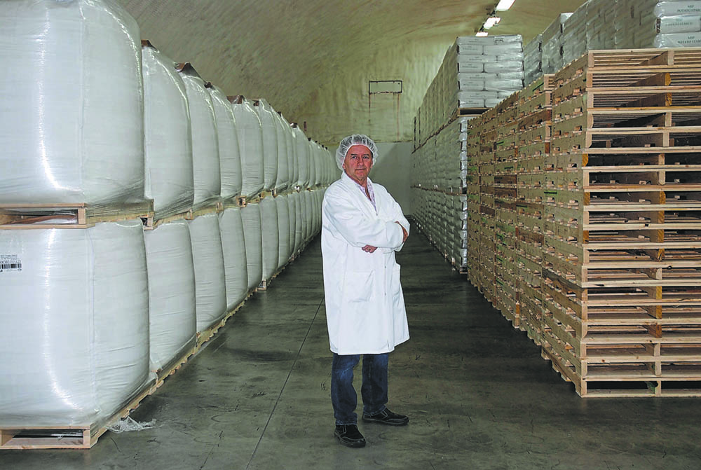 Derek McLaren, vice-president of Manitoba Starch Products Ltd., in Carberry, stands in the warehouse surrounded by the MPSPrebiotic starch his company produces to help people with gut health.