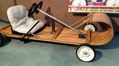 "A soapbox car built by Kiwanis Club president Vern Gilbertson. ""In the past we have cars built as a milk carton, fire engine, a grand piano and a toboggan like the picture I sent you,"" Gilbertson said."