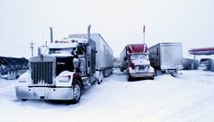 Dozens of semi trucks were stranded at the Husky station along the Trans-Canada Highway overnight on Monday and into Tuesday morning, as a blizzard blew through Westman.