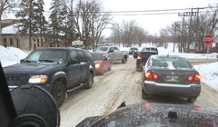 A mess of vehicles attempt to negotiate 26th Street and McDonald Avenue just after a train has passed last week.