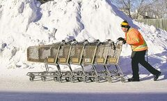 Safeway employee Angelo Santilli gets a cold workout collecting shopping carts.