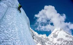 Former Brandonite Ian Welsted and his climbing partner Raphael Slawinski were the first to climb to the top of the western summit of K6 in Pakistan in June and have been nominated for a National Geographic award for the feat. In this photo, Slawinski climbs on vertical ice with Kapura Peak in the background.
