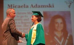 Principal Michael Adamski shakes the hand of his niece and graduate Micaela Adamski during yesterday's Ecole Secondaire Neelin High School's graduation ceremony held at the Western Manitoba Centennial Auditorium.