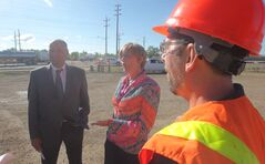 MLA Drew Caldwell and Mayor Shari Decter Hirst at the intersection of 17th Street East and Richmond Avenue. The intersectio construction, which is completed now, was the site of a shared-cost improvement as part of the Urban Highway Fund.