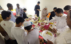 Members of the Islamic community break their month-long fast for Ramadan during Monday morning's Eid celebration at the Westman Islamic Centre.