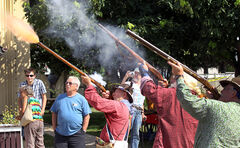 Smoke and gas blows out of the barrel of Chuck Vidnes' muzzle loader as he fires off some black powder with members of the Manitoba Muzzleloader's Association during the Carberry Heritage Festival.
