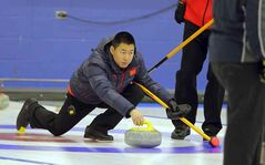 Rui Liu throws a stone during Sunday's competitive division final. Liu's rink defeated Jerry Chudley's foursome 7-1.