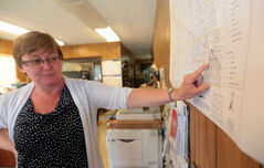RM of Wallace CAO Janice Thevenot locates areas of flooding concerns on a map in the RM's office on Wednesday afternoon. Mandatory evacuations along the Bosshill Creek have been issued for residents as a precaution for a possible surge of water being held back by highways and roads.