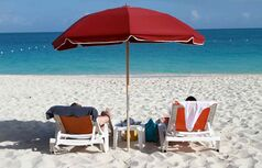 Grace Bay Beach is a 12-mile stretch of sparkling white sand on the Islands of Providenciales, Turks and Caicos.