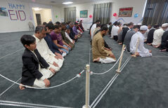 Muslims take part in morning prayers.