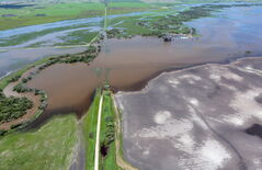 Floodwaters on the Souris River near the community of Napinka, Man. Thursday.