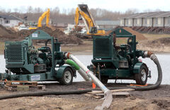 City pumps sit idle along First Street south of Crocus Plains high school on Wednesday afternoon. The drainage has sparked concerns among nearby residents and RM of Cornwallis officials.