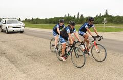 Hughes on her Big Ride on the Trans-Canada Highway near Carberry after leaving Brandon Friday.